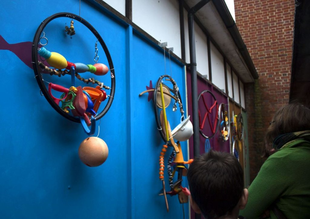 Colourful wall sculpture made from recycled material