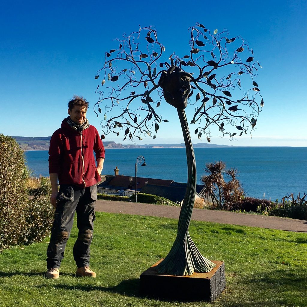 Brendan Murless with his sculpture 'The Air We Breathe'