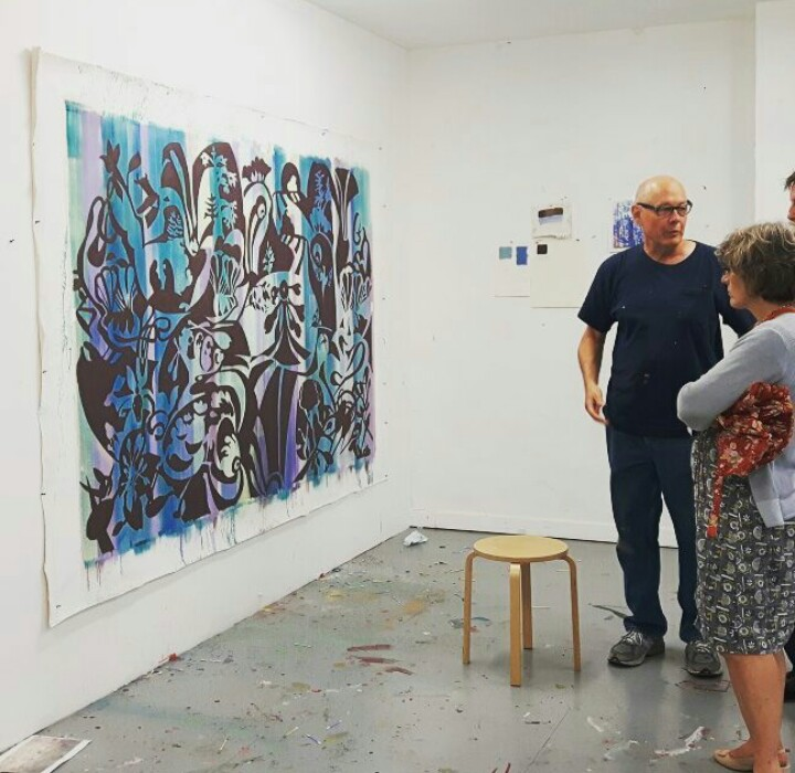 Visitor admiring painting in gallery