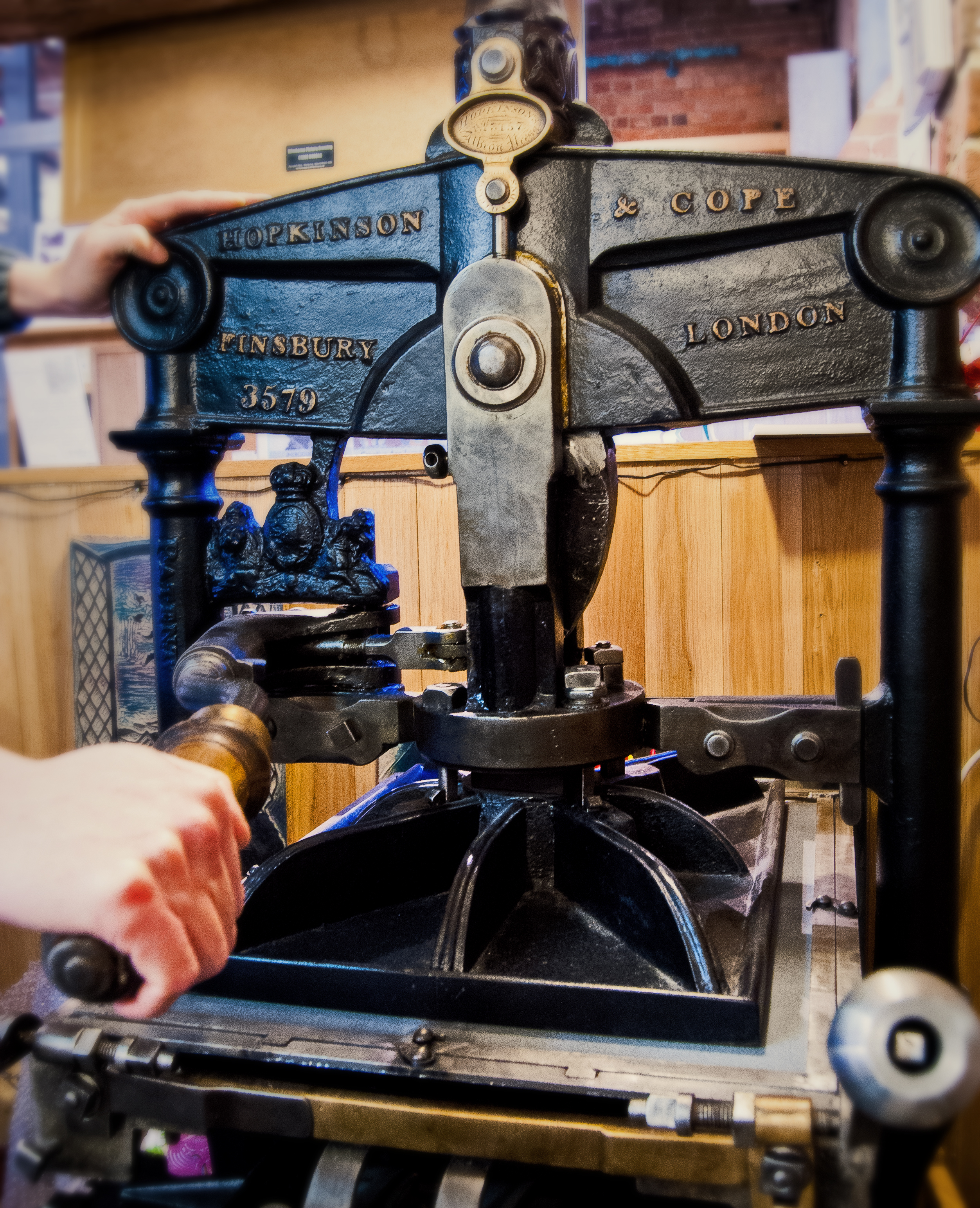 Vintage printing press Robin's uses at his studio