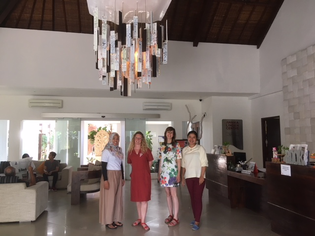 four ladies standing in the lobby of Annika Linden centre a white room with an interesting hanging lamp