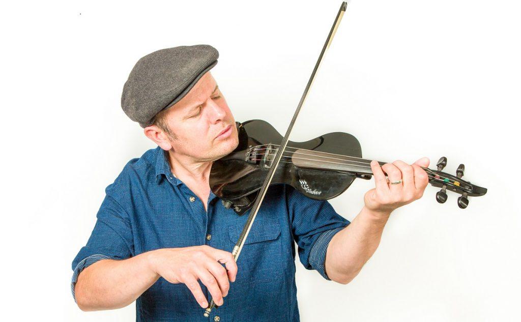 Dan Baker playing a violin